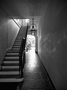 While walking around the French Quarter in New Orleans (I was there for a close friend's wedding), I happened to walk into this quiet home/museum. Considering how crowded and loud everything was right by, this place stood out for the near-silence in it. Not far from the entrance, there was this beautiful stairway. It had been raining earlier, but I waited a few moments and happened to catch a little light coming through. This place felt so New Orleans - the shadows seem to hide stories from the building's past, and the entire place was both beautiful and haunting.