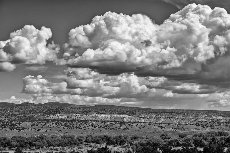 Cumulus clouds over mesa near Abiquiu, New Mexico