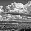 Cumulus clouds over mesa near Abiquiu, New Mexico