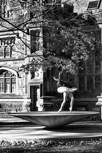Waking through Princeton University with my fiancee on a chilly fall day, we came across a group of ballerinas warming up outside. Despite the cold weather, they decided to follow through with their outdoor practice. After asking them permission, I waited for this shot for a few minutes as the ballerina warmed up. It makes no sense for a ballerina to be practicing outdoors in cold weather with a historic university building behind her, but that contrast is why I love this shot. It shows an artist at work, focused on her craft, with no concern about her surroundings.