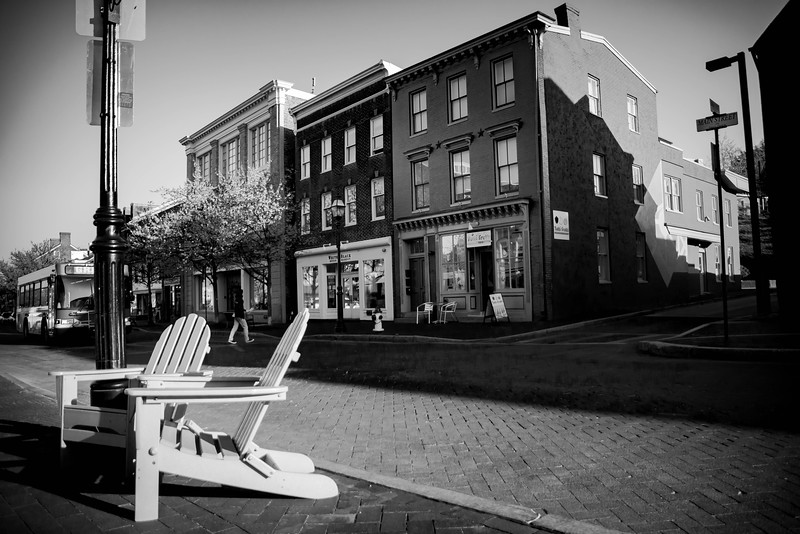 Adirondack chairs and businesses on Main Street in Annapolis, Maryland.