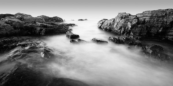 The ocean flows back out through the rocks on the Marginal Way in Ogunquit, Maine.