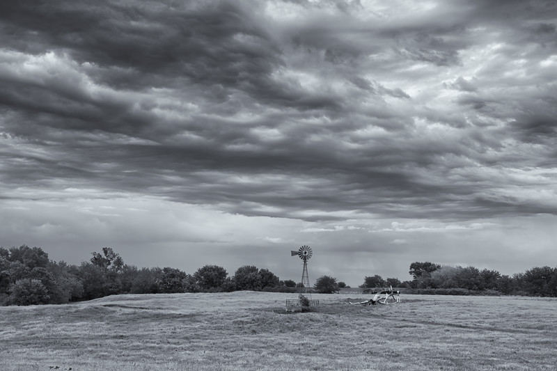 Windmill and stormy skies near Wood River, Nebraska