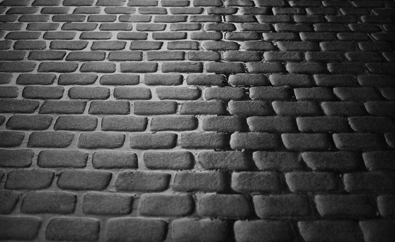 cobblestone street in the rain