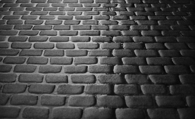 cobblestone street in the rain