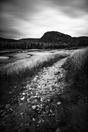 Path through the dunes winds towards the Beehive near Sand Beach in Acadia National Park, Maine.