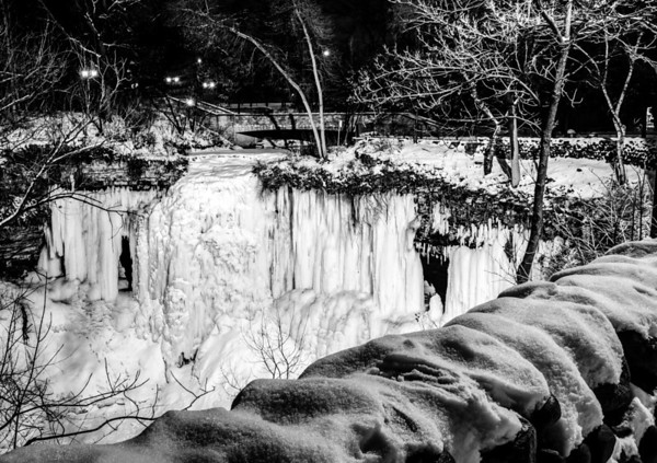 The Frozen Falls at Night (In Black and White) - Minnehaha Falls in Minneapolis becomes a collection of ice columns in January