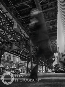 This is one of my favorite shots. I wanted to get something that captured the vertical nature of the L Train tracks in Chicago. As such, I opted to get low, putting my camera next to the ground as I lay down waiting for a shot I liked. After a minute, got up and decided to rest the camera itself on the ground. With a little slower shutter speed, I waited for a single pedestrian to walk by and create the foreground I wanted for the shot. This took longer than normal....because its Chicago, when do you get just one pedestrian crossing a major intersection?