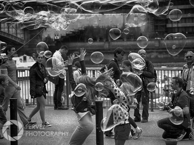 Kids playing with bubbles in front of the Tate Modern Museum in London. I walked out of the museum and saw people setting up for some epic bubble action. It took them a good 10 minutes to set up, as a handful of kids ran over and waited eagerly (as did I, because I had a good feeling the photos were going to be special). Once they set up, it was pandemonium. So many huge bubbles, so many happy children running after them. This shot also reminds me of the simple things in life, which is largely why I wanted to shoot it in the first place. In a world with so much chaos and violence, there is something really pleasing about a photo like this that should remind us to appreciate little things, as well as to be active to protect children from the horrors of violence all around the globe. I often post this photo when discussing political violence to remind people that children are innocent and deserve a chance to play with bubbles instead of battling disease, poverty, racism, or air strikes. So, I love this shot for what it is, for how it developed, and for what it symbolizes to me.