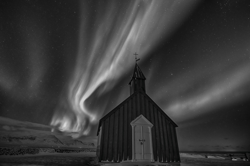 Northern Lights over Black church at Budir on the Snæfellsnes Peninsula, Iceland