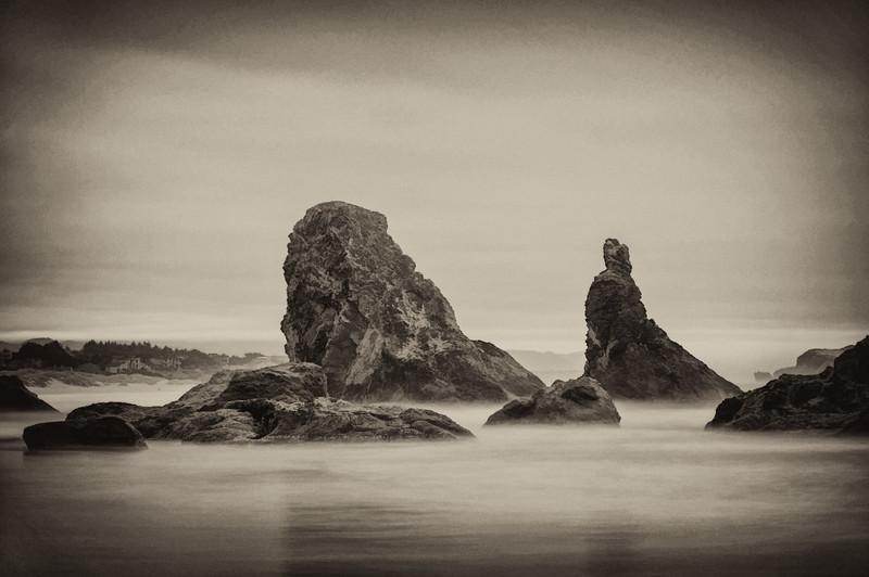 Long exposure of waves against sea stacks at sunset on Bandon Beach, Oregon Coast