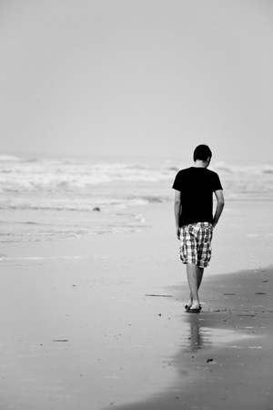 Walking from boyhood to manhood isn't easy and often lonely. This is an image of my nephew as a teenager walking on the beach. What he was thinking is anyones guess.