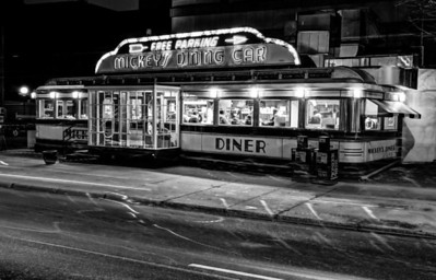 Mickey's at Night - Ghostly cars drive by as the iconic downtown Saint Paul diner hosts an evening crowd.