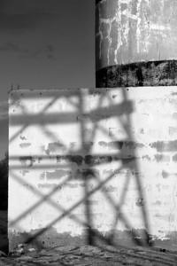 The shadow of a new lighthouse on the bricks of the old lighthouse. Isla San Jose, Baja California. November, 2013.