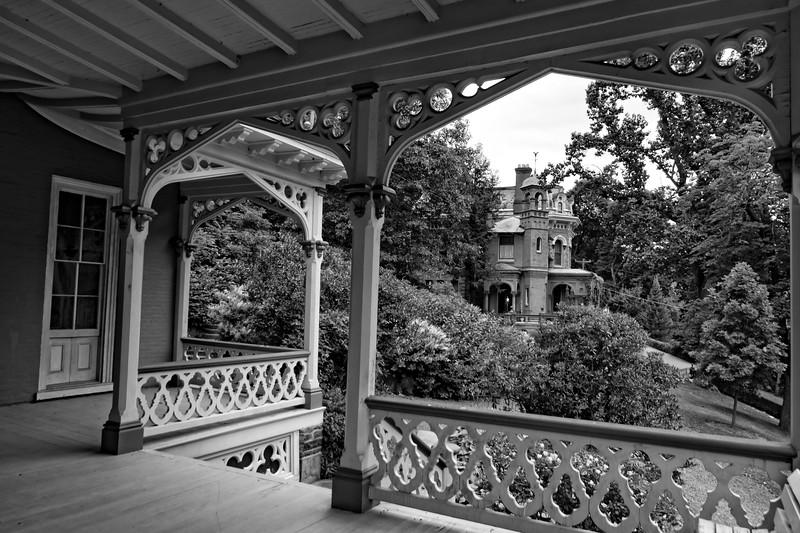 Side view of porch at Asa Packer museum and Harry Packer mansion in the distance.