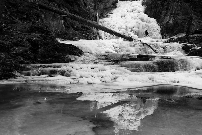 Frozen cascade falls reflected in Saco, Maine.
