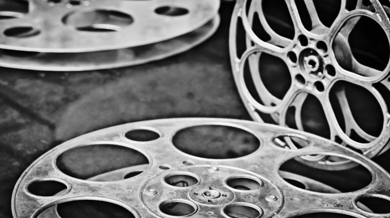 reel to reel <p></p> <p>Photographed at the historic Alabama Theater in Birmingham, AL  Equipment used and camera settings: <ul>    <li> Nikon D700 Camera</li>    <li> Zeiss Makro-Planar T* 2/100 ZF.2</li>    <li> Focal length - 100mm</li>    <li> Tripod</li>    <li> Cable release</li>   <li> Metering Mode - Matrix</li>    <li> ISO 100</li>    <li> EV (exposure value) +0.67</li>    <li> Aperture f/5.6</li>    <li> Shutter Speed 1/20th second</li>    <li> White Balance - Auto</li>    <li> Bit Depth 16</li>   </ul>