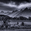 Crepuscular rays streaming through the Tetons