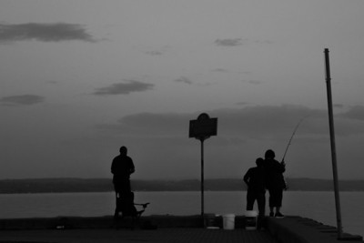 fishermen at city pier