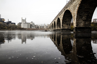 Misty Morning in Minneapolis (2 of 3) - The modern skyline is obscured by fog, leaving only the original milling district at the end of the Stone Arch Bridge.
