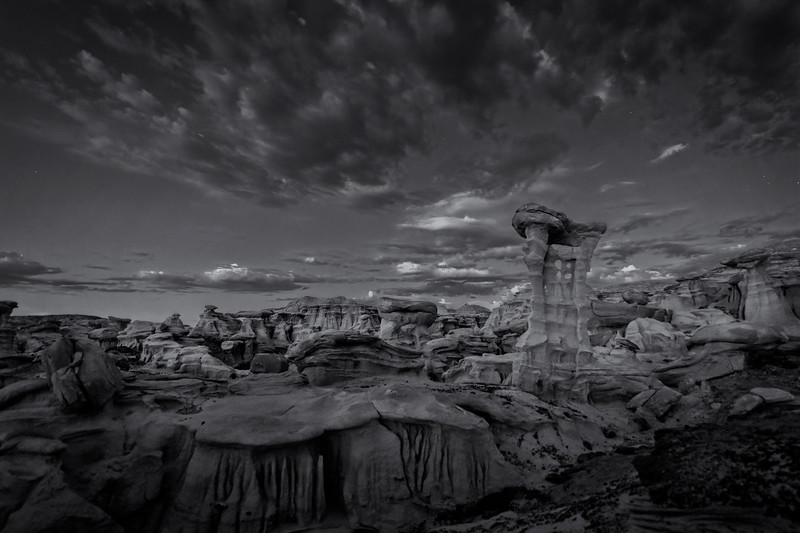 """Stars and clouds over the """"Alien Throne"""" and other hoodoo sandstone rock formations in the Valley of Dreams in the Ah-Shi-Sle-Pah Wilderness Study Area, New Mexico"""