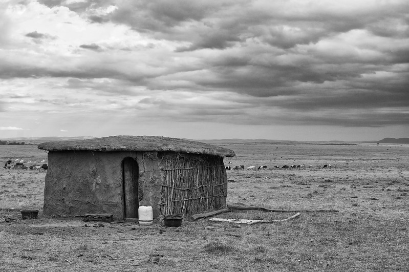 Traditional Masai Mara mud hut, in black and white
