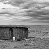 Traditional Masai Mara mud hut, in black and white