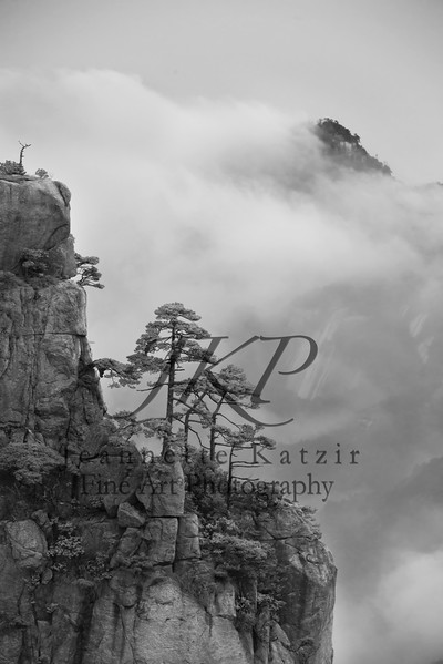 """China's Mt. Huangshan """"Yellow Mountains,"""" engulfed in a cloud, in black and white"""