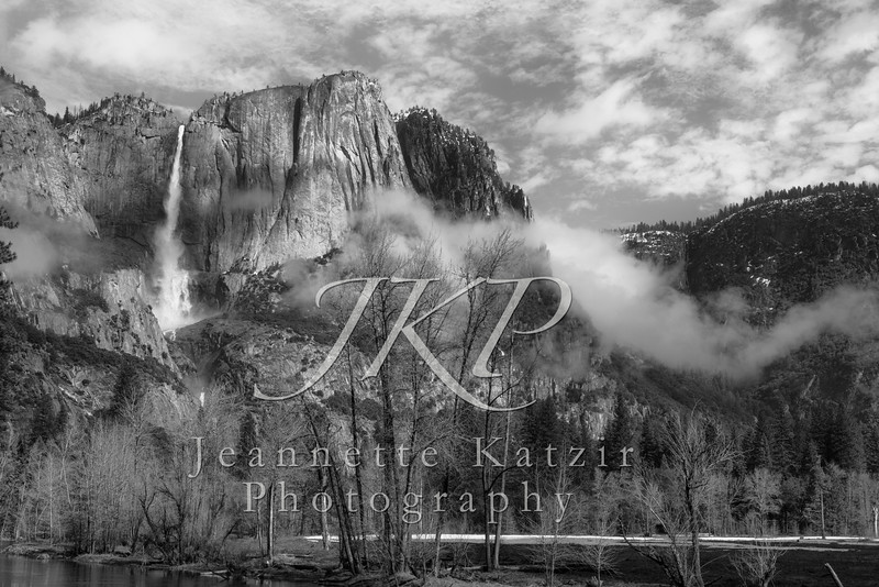 Cloud covered Yosemite waterfall, in black and white