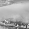 Portugal's Porto skyline beside the river at dusk with clouds in black and white