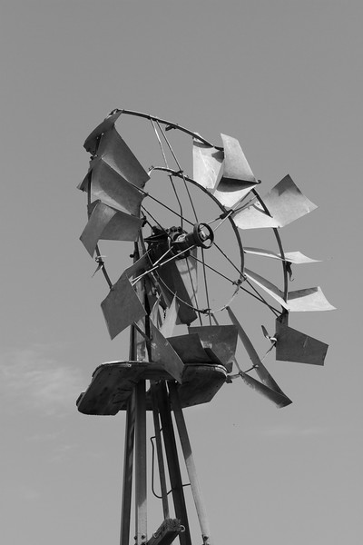 Damaged windmill in black and white