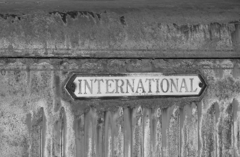 International emblem on abandoned truck.