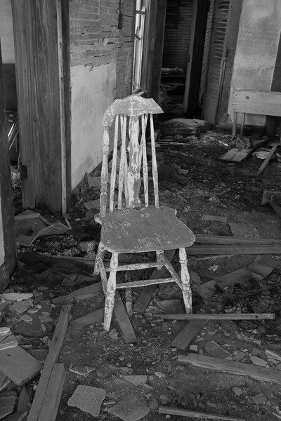 Peeling chair in forgotten farm house