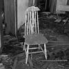 Peeling chair in forgotten farm house