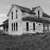 Rural abandoned two story farm house.