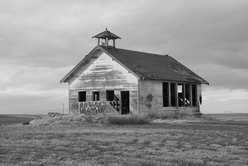 Abandoned high line school house in black and white.