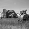 Forgotten farm house and combine.