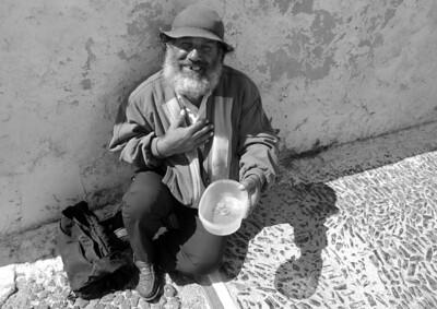 Happy Beggar, Santorini, greece