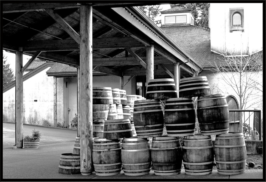 Wine barrels stacked outside an Oregon winery