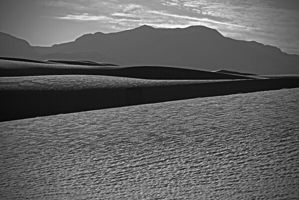 White Sands National Monument, New Mexico, composed of gypsum and calcium sulfate from the San Andres mountains behind.