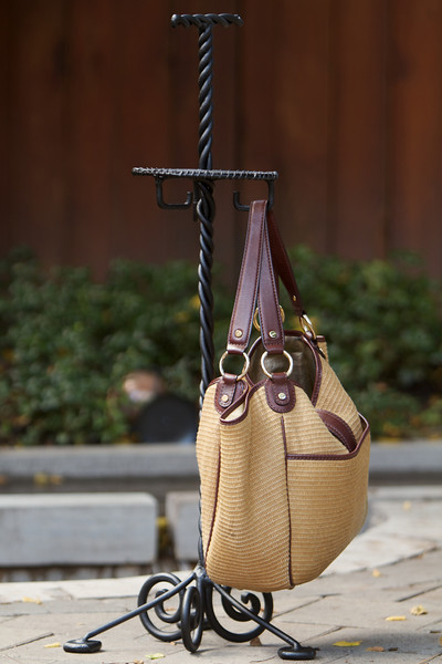 Purse holder with purse, as a demonstration of how it can be used.