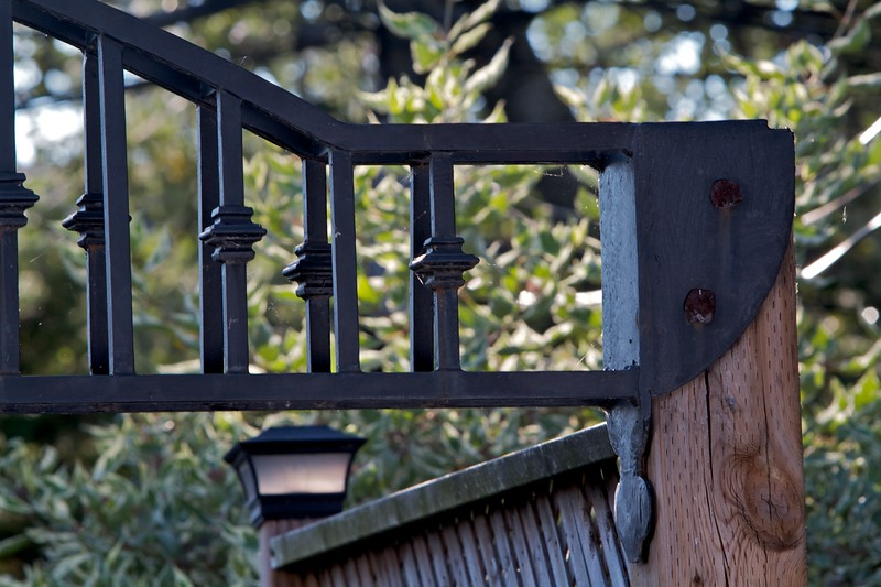 Post transition, you can see the sort of blending of times with the almost medieval shape of the heavy metal and hand forged bolts with the straight lines of the gate portico, and the solar powered light in the background.