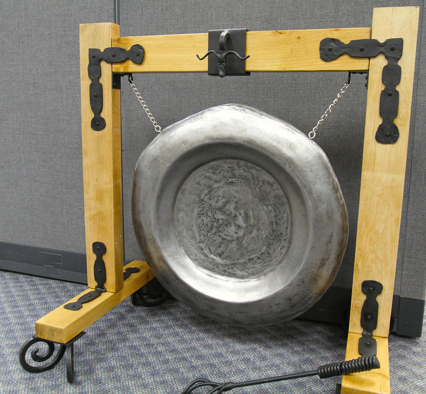 Celebratory gong.  This is used to celebrate the gaining of a new customer in a sales office.  It makes quite a sound.
