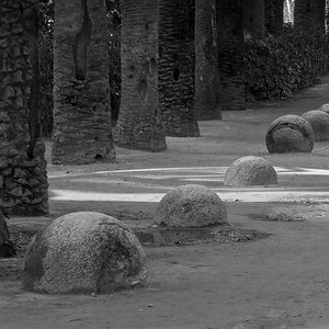 Parc Guell.  Gaudi used a string of boulders reminiscent of rosary beads to line the road