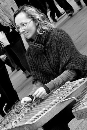 Street performer playing hammered dulcimer