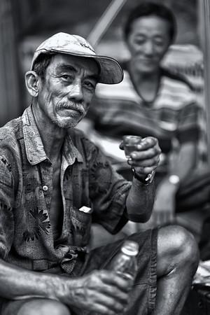 Toasting man in Saigon.