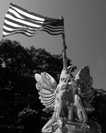 Flag on Veteran Memorial in SS Peter & Paul Cemetery, Naperville, Illinois