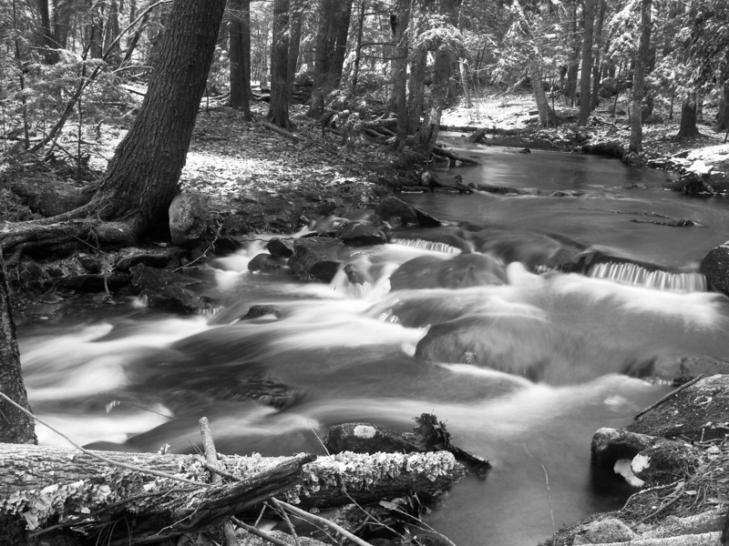 Morning at Tucker Brook, Milford NH<br /> December 2009<br /> <br /> I nearly fell in to get this one.  Tripod arranged at a most precarious angle.