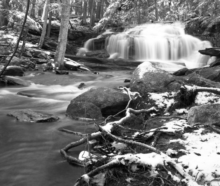 Tucker Falls, Milford NH, December 2009<br /> <br /> Winter just lends itself to b&w with the wide tonal range it imparts.  Plus most of the color has bled from the landscape anyway.