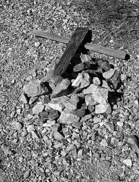 Downed cross in Bullfrog Mine Cemetery near Rhyolite (ghost town) Nevada.  2007.
